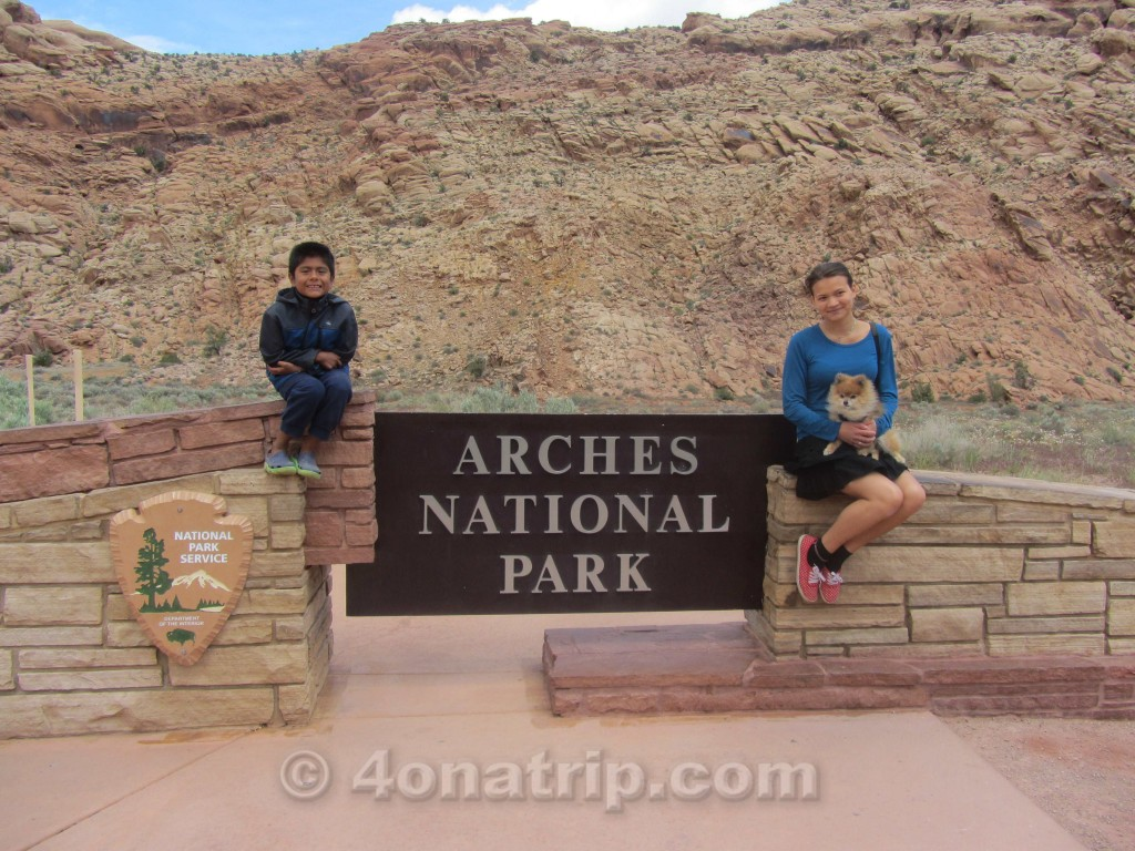 Arches National Park sign with kids